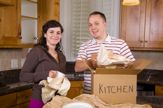 A young couple standing in their new home kitchen