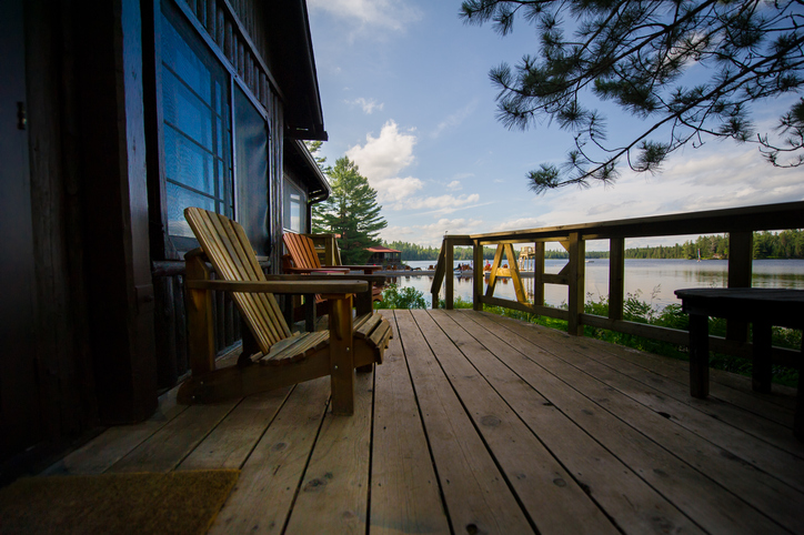 Muskoka chairs on a wooden deck