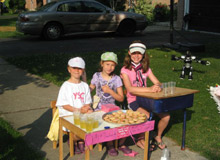 Photo of kids selling Cookies and Lemonade