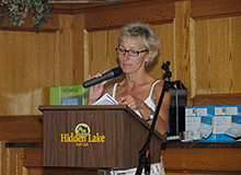 Photo of Lori VanDinther organizing the RE/MAX Escarpment Annual Charity Golf Tournament
