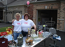 Photo of Lori VanDinther hosting a yard sale to raise funds for Treatment & Research of Breast Cancer